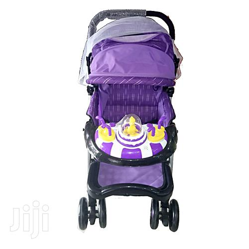 Archive: Generic Baby Stroller/ Foldable Pram - Purple, White and Black
